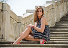 Gorgeous girl sitting on marble stairs Stock Photos