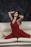Gorgeous girl on the sofa. Young woman with gorgeous look Stock Image
