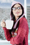Gorgeous girl in warm clothes enjoy hot coffee Stock Images