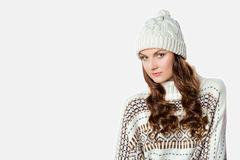 Gorgeous girl wearing warm knitted christmas jumper and a hat Stock Photos