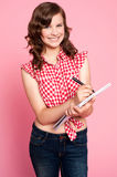 Gorgeous girl writing on notepad Royalty Free Stock Image