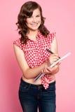 Gorgeous girl writing on notepad Royalty Free Stock Image