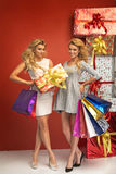 Gorgeous girlfriends presenting Christmas gifts Stock Image