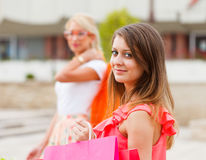 Gorgeous Girls Out in City Shopping. Happy women shopping in the city together Royalty Free Stock Image