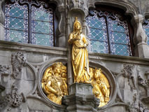 Gorgeous Golden Sculptures on the Facade of a Historic Building in Bruges Stock Photo