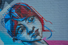 Gorgeous graffiti of a surprised looking young boy Royalty Free Stock Image