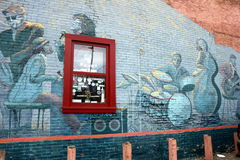 Gorgeous grafitti of jazz band on brick wall,Saratoga Springs,New York,Summertime,2013. Interesting street art of jazz band and singer,painted on old red brick Royalty Free Stock Photos