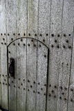 Gorgeous grain in old wood door with rusted handles and hardware Royalty Free Stock Photos