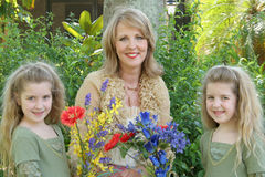 Gorgeous grandmother and child. Shot of a Gorgeous grandmother and children with flowers Royalty Free Stock Images