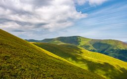 Gorgeous green rolling hill in summer Royalty Free Stock Images