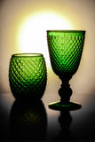 Gorgeous green wine cups with a bright sun on the background. Gorgeous green cups with a bright sun on  the background Royalty Free Stock Image