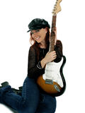 Gorgeous Guitarist. Beautiful redhead with an electric guitar. Isolated over white royalty free stock photography