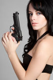 Gorgeous Gun Woman royalty free stock image