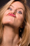 Gorgeous gurner. Glamorous blonde woman pulling a silly face stock photos