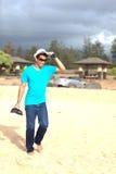 Gorgeous Guy walking along Kealia Beach Kauai Stock Photography