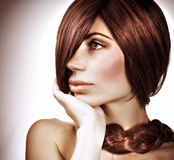 Gorgeous hairdo. Closeup portrait of of gorgeous model with fashionable hairstyle, healthy long hair, looking on side, stylish hairdo, luxury hairdressing salon stock image