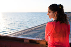 Gorgeous happy female with beautiful figure warm up exercising at seaside Royalty Free Stock Images
