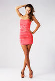 Gorgeous happy model in pink gown Royalty Free Stock Photography