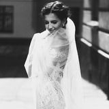 Gorgeous happy smiling brunette bride in vintage white dress pos Royalty Free Stock Photos