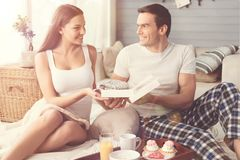 Gorgeous happy woman grateful for present. Thank you, my love. Stunning emotional pretty lady receiving a lovely surprise from her boyfriend while they spending Royalty Free Stock Images