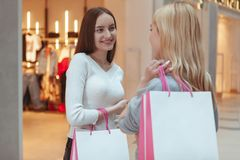 Young women enjoying shopping together at the mall stock images