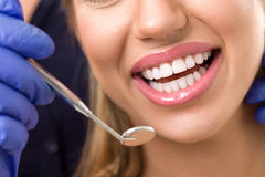 Gorgeous healthy smile with dentist mirror royalty free stock photography