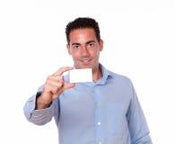 Gorgeous hispanic man holding a blank card Stock Image