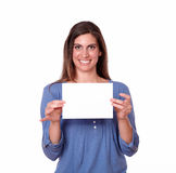 Gorgeous hispanic woman holding white card Stock Image