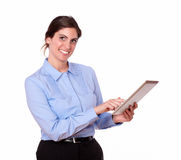Gorgeous hispanic woman smiling with tablet pc Stock Photos