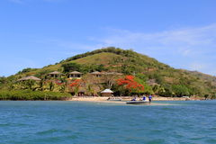 Gorgeous image of Volivoli Beach Resort, with sun and sand and diving boat coming to shore,Fiji,2015 Royalty Free Stock Photo