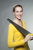 Gorgeous independent girl smiling in repairing and fixing home herself Stock Photography