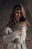 Gorgeous indie woman posing in handmade boho clothes. Gently emotion stock photo