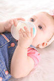 Gorgeous infant drinking bottle. Shot of a gorgeous infant drinking bottle Royalty Free Stock Photo