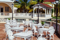 Gorgeous inviting view of Memories resort landscape, outdoor cafe, patio with metal vintage retro classic chairs at early morning Royalty Free Stock Photography