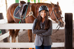 Gorgeous jockey and her horse Stock Photos