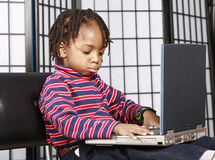 Gorgeous kid with a computer Royalty Free Stock Image