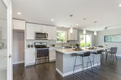 Gorgeous kitchen with open concept floorplan. stock photography