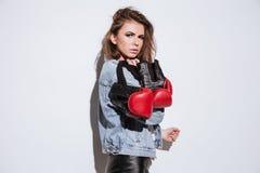 Gorgeous lady boxer  over white background Royalty Free Stock Photos