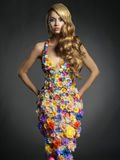 Gorgeous lady in dress of flowers. Studio portrait of blooming gorgeous lady in dress of flowers Royalty Free Stock Photos