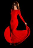 Gorgeous lady in a long red dress Royalty Free Stock Images