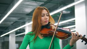 Gorgeous lady is playing the violin professionally. 4K stock video