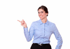 Gorgeous lady pointing to her right Royalty Free Stock Image