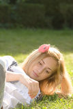 Gorgeous lady relaxing on grass Royalty Free Stock Images