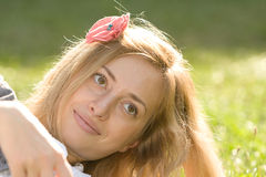 Gorgeous lady relaxing on grass Stock Photos