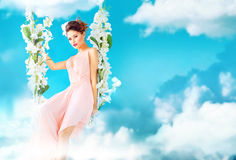 Gorgeous lady swining in the paradise Royalty Free Stock Image