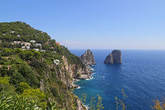Gorgeous landscape of famous faraglioni rocks on Capri island, Italy. Stock Images