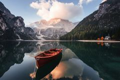 Free Gorgeous Landscape. Wooden Boat On The Crystal Lake With Majestic Mountain Behind. Reflection In The Water. Chapel Is On Stock Image - 165454191
