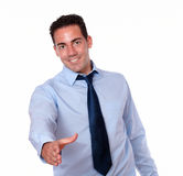 Gorgeous latin male with greeting gesture Stock Photo