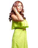 Gorgeous latina with long wavy red tinted hair. And brown eyes in lime green dress Stock Photo