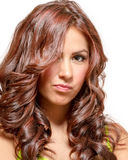 Gorgeous latina with long wavy red tinted hair. And brown eyes in lime green dress Royalty Free Stock Photo